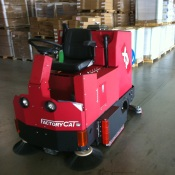 Large industrial warehouse floor cleaning machinne